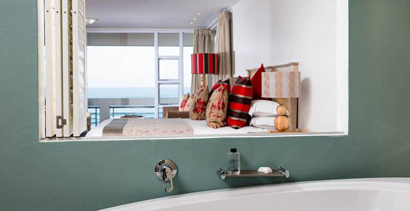 The interior of a suite at the Arniston Hotel reflcted in the en suite bathroom's mirror.