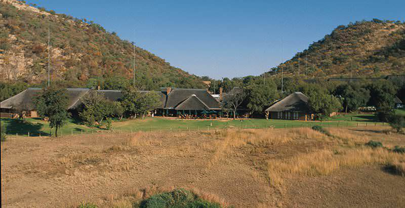 The exterior of Bakubung Bush Lodge with its handsomely thatched structures.