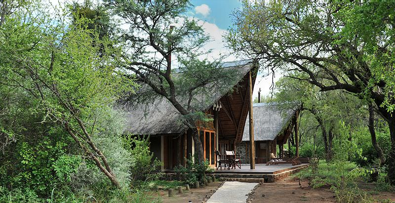 The exterior of a thatched chalet at Black Rhino Game Lodge.