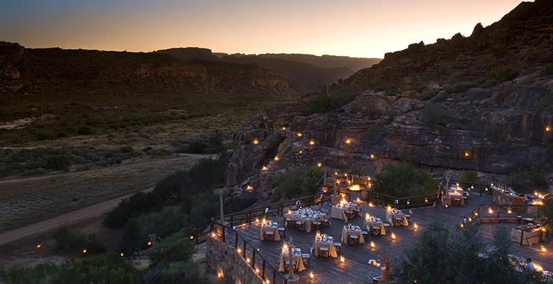 A special, lantern-lit dinner prepared at Bushmans Kloof with views across the Cederberg wilderness.
