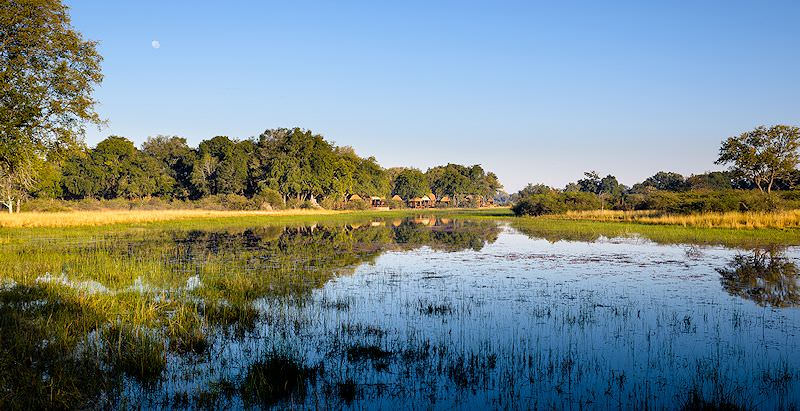 Chief's Camp as seen from across the waters of the Okavango Delta.