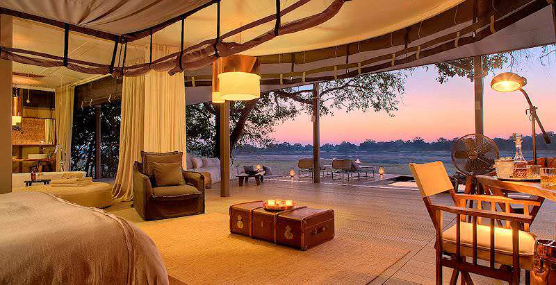 The opulent interior of a luxury tented villa at Chinzombo Lodge in the South Luangwa National Park.