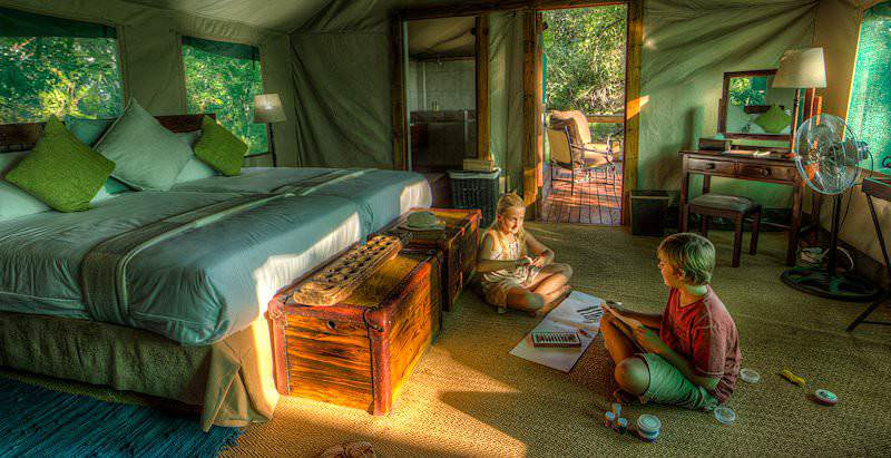 Children entertain themselves in a tented suite at Camp Moremi.