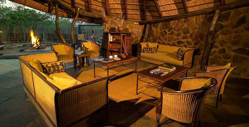 The cozy main lounge area of the semi-luxurious Entabeni Wildside Camp in South Africa's Waterberg region.
