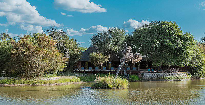 Gomo Gomo Game Lodge as seen from across its resident waterhole in the Klaserie Game Reserve.