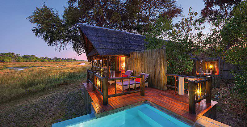 A sumptuous suite with a private plunge pool overlooks the wilderness of the Okavango Delta at Khwai River Lodge.