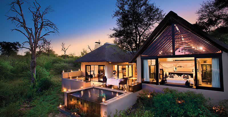 The exterior of a palatial private villa at Lion Sands Ivory Lodge in the Sabi Sand Private Game Reserve.