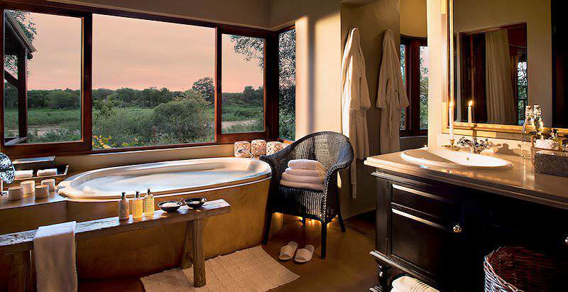 The sumptuous en suite bathroom of a luxury suite at Lion Sands Tinga Lodge in the Kruger National Park.