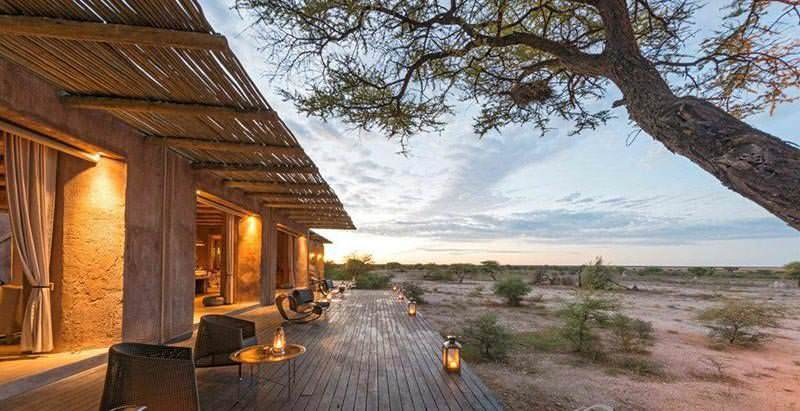 The deck of Onguma the Fort overlooks the breathtaking wilderness of Namibia's Greater Etosha National Park.