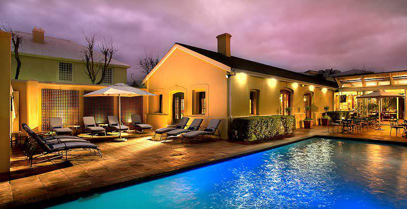 The pool area at The Portswood Hotel lit up as dark storm clouds roll in.