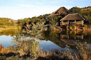 Shamwari Bayethe overlooks a lake in the wilderness.