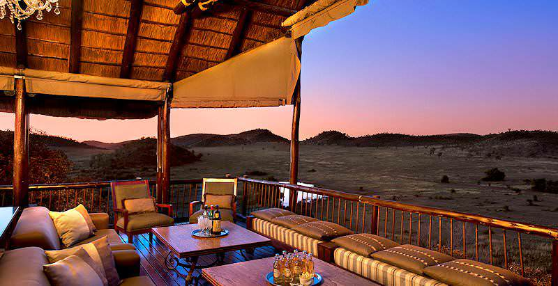 A pink dusk blankets the wilderness of the Pilanesberg Game Reserve that surrounds Tshukudu Bush Lodge.