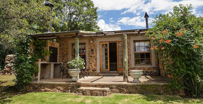 The exterior of a stone cottage at Wetlands Country House in the sleepy Mpumalanga town of Wakkerstroom.