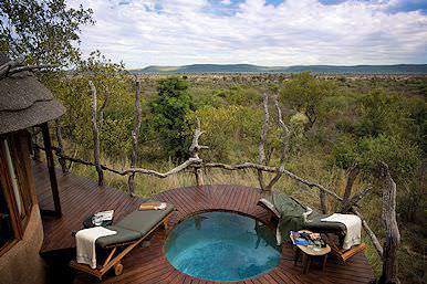 The plunge pool and private deck of a luxurious suite at Madikwe Safari Lodge.