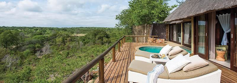 A private deck and plunge pool of a luxury safari suite.