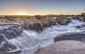 The sun sets over the grand gurgle of the Augrabies Falls.