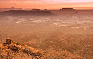 The breathtaking semi-arid landscape of the Karoo at sunset.
