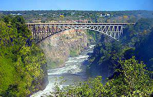The Victoria Falls Bridge spans the gorge.