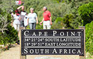 A sign indicating the longitude and latitude of Cape Point.