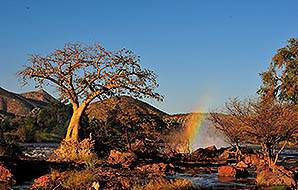 A rainbow forms above the Epupa Falls in the Caprivi region.