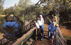 A family on a wooden walkway.