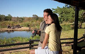 A newly-wed couple enjoying a honeymoon safari.