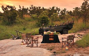 A table set up for an early dinner in the bush.