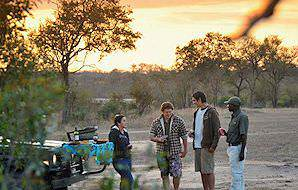 Guests enjoy a mid-safari sundowner at Djuma in the Sabi Sand.