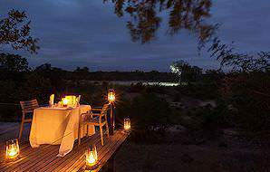 A private dinner with a view of the wilderness at Simbambili Lodge.
