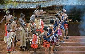 Visitors enjoy a traditional performance at Shangana Cultural Village.