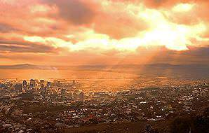 The city of Cape Town bathed in a golden sunset.