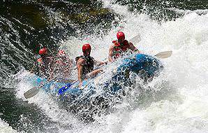 A raft hits a rapid in the Batoka Gorge.