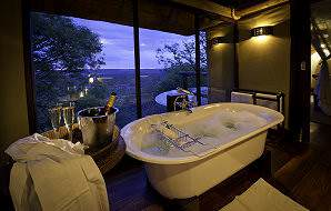 Enjoy a bubble bath with a view of the wilderness at Little Ongava in Etosha.