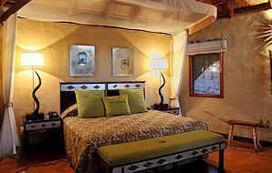 The interior of a Classic Suite at Lukimbi Safari Lodge.