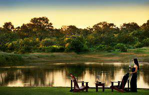 A guests at Arathusa Safari Lodge enjoys a drink with a view.