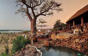 The deck area of Ngoma Safari Lodge built around a young baobab with views of the Chobe floodplains.