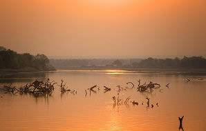 The sun sets over the Luangwa River in Zambia.
