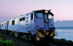 The Blue Trains passes by Table Bay.