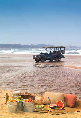 A Phinda Private Game Reserve vehicle parked along the beach in northern KwaZulu-Natal.