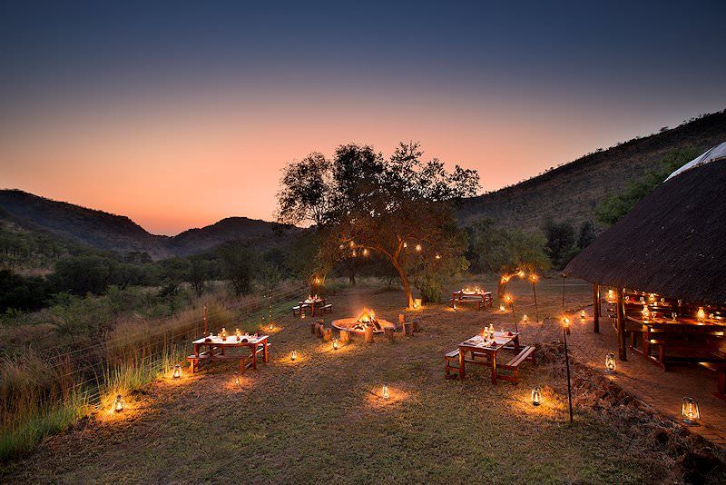 A lantern-lit outdoor dining experience at Bakubung.