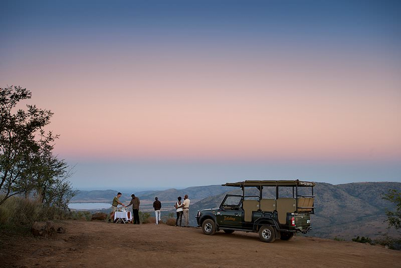 Guests stop for a refreshment during a game drive in Pilanesberg.