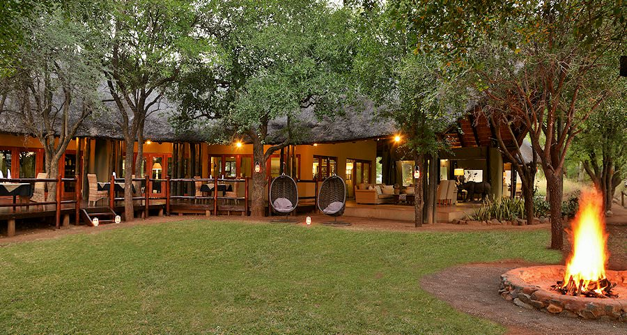 A fire is prepared as dusk settles over Black Rhino Game Lodge.