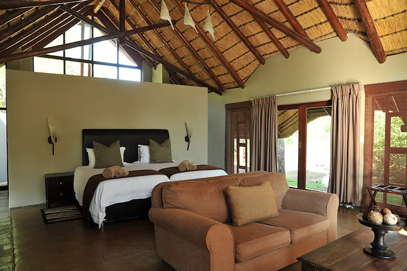 The lounge and bedroom area of a suite at Black Rhino Game Lodge.