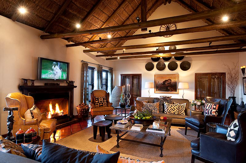 A roaring fire welcomes guest to the lounge area at Bushmans Kloof.