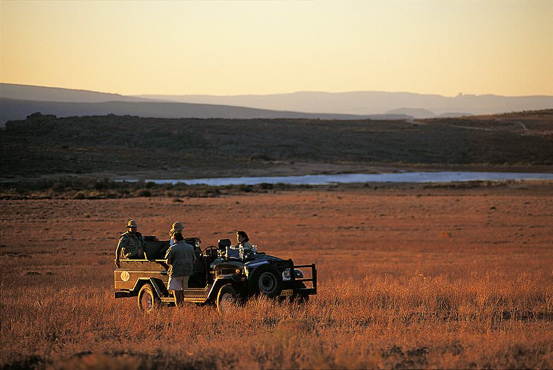 A nature drive ventures out into the reserve at sunset.