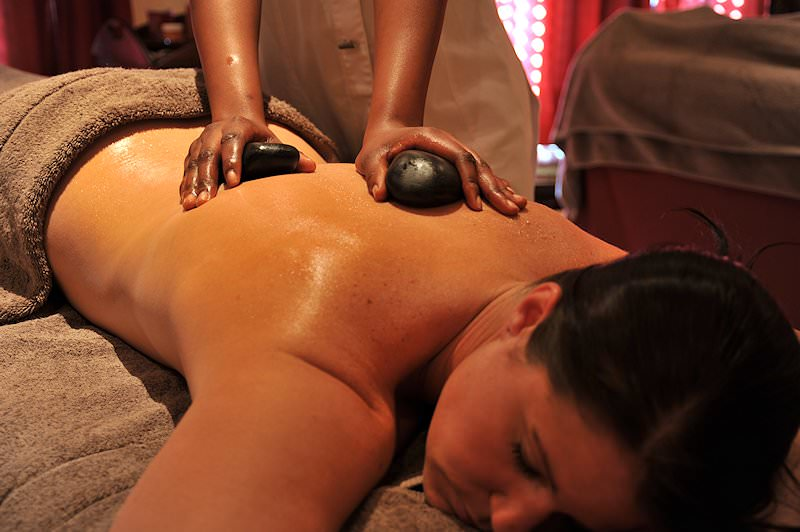 A guest enjoys a hot stone massage at The David Livingstone Safari Lodge.