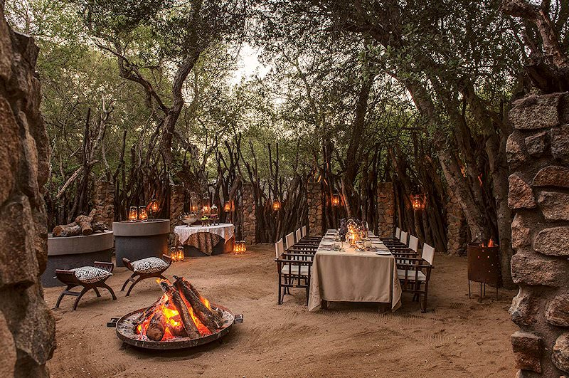 Lanterns and a fire pit light up the boma area at Dulini.