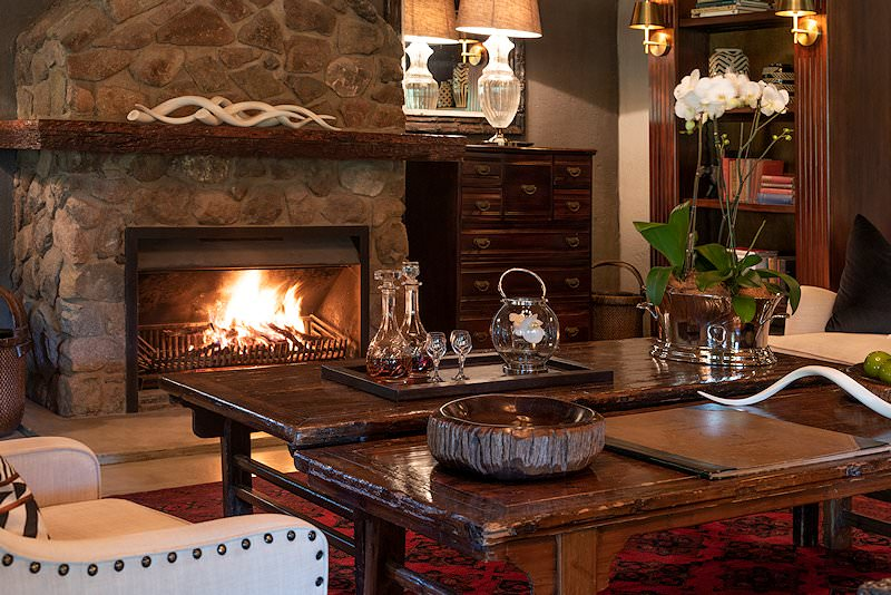 A roaring fire crackles in the lounge at Dulini Lodge.