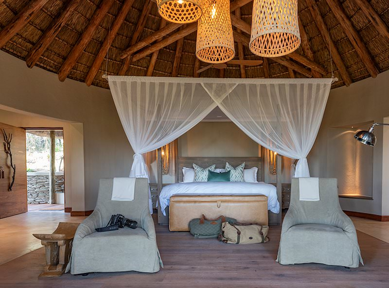 A front-angle view of a four-poster bed at Dulini River Lodge.