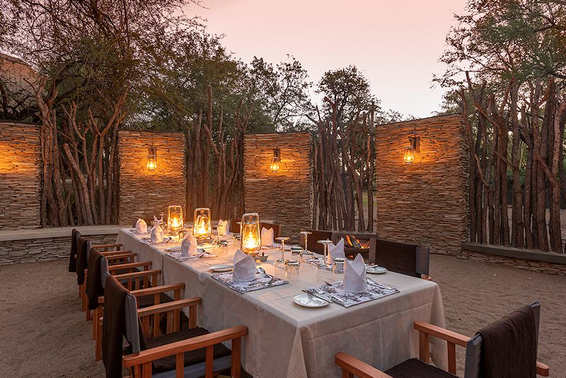 The boma is prepared for an intimate outdoor dining experience.